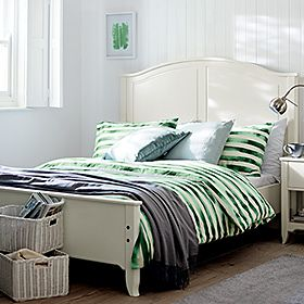 Striped green bed set on white bed