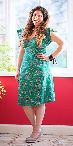 Blogger Vicki Psarias wearing green printed dress