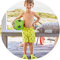 Boy wearing swim shorts