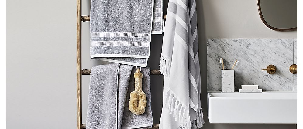 Bathroom with grey towels