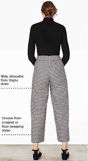 Model wears wide leg trousers