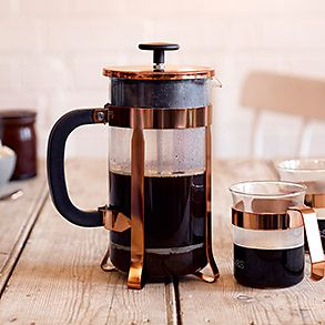 A copper-detailed cafetière