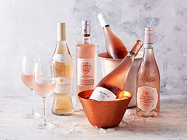 Bottles of rosé wine with glasses