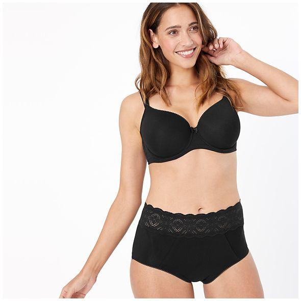 Woman wearing black Confidence shorts with lace trim and bra