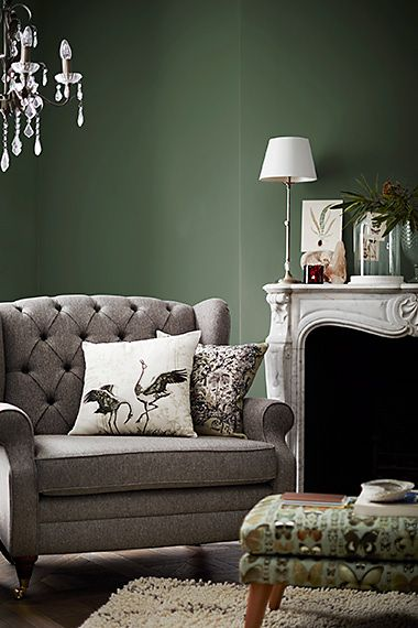 Grey armchair with butterfly print footstool