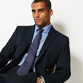 Man wearing navy suit