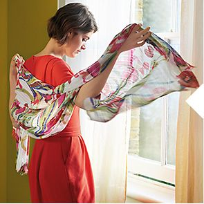 Woman wearing floral silk scarf
