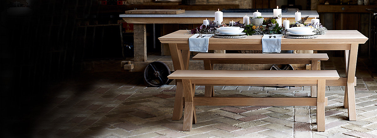 An extending dining table and wooden benches