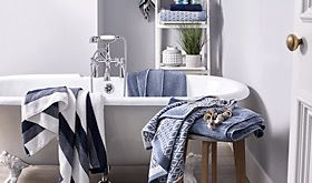 Bathroom with freestanding bath and towels