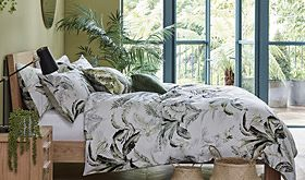 Patterned bedding on a wooden bed