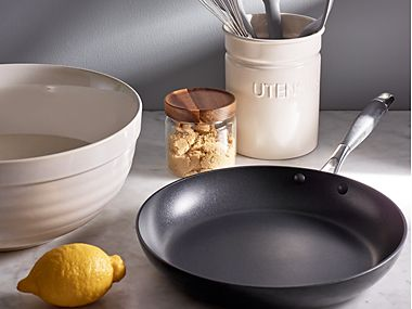A frying pan and kitchen storage