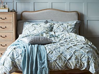Bed with embroided duvet cover
