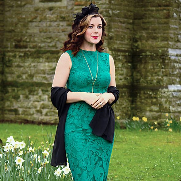 Blogger Rachel Turore wearing a green sleeveless dress