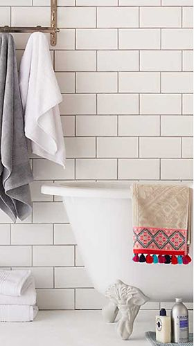 Bath towels and hand towels on towel rail and bath