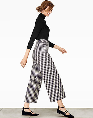 Model wears wide-leg trousers