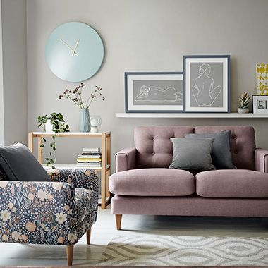 Floral print armchair and pink sofa in modern living room
