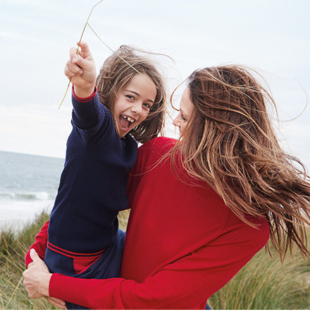 Mother and daughter wearing M&S knitwear