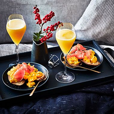 Scrambled eggs and salmon with glasses of bucks fizz