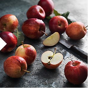 Sliced and whole Gala apples