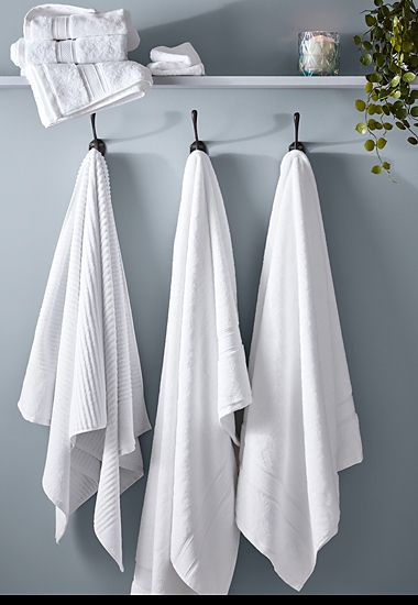 White and grey towels on a towel rack
