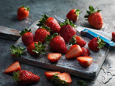 A board with freshly cut strawberries