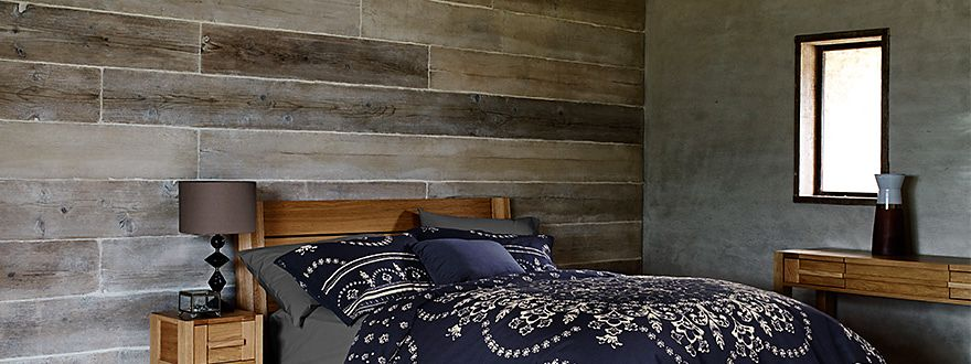 Wooden bed with chandelier print bedding