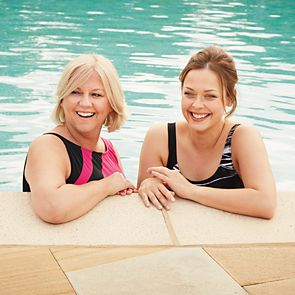 two women swimming together