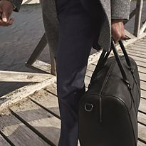 Man carrying leather bag