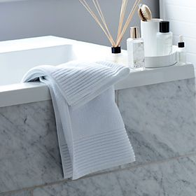 White towel, diffusers in bathroom