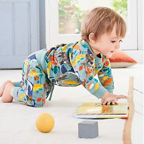 Baby boy wearing colourful  printed pyjamas