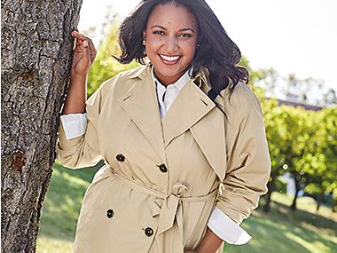 Model wearing a beige trench coat from the Curve collection