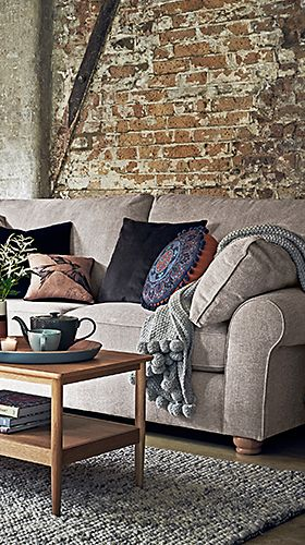Ramsden sofa with cushions and throws
