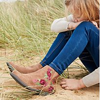 Girl in sand dunes wearing short suede ankle boots