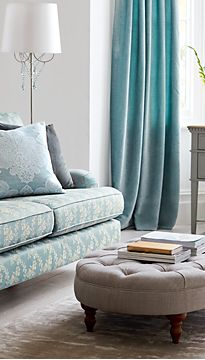 Floral patterned sofa and footstool