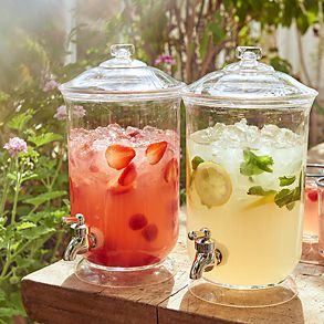 Drinks dispensers with lemon and berry drinks in garden