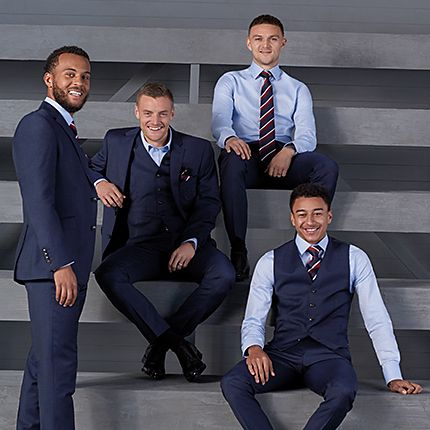 (Left to right) England footballers Ryan Bertrand, Jamie Vardy, Kieran Trippier and Jesse Lingard wearing the official England suit for the 2018 World Cup