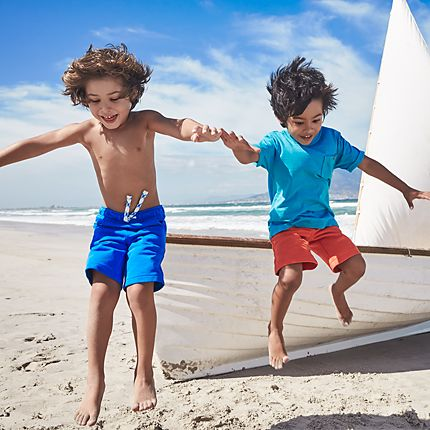 Children playing in swimwear on the beach