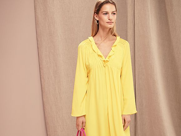 Woman modelling yellow dress