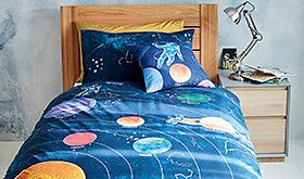 Wooden bed with children's bedding
