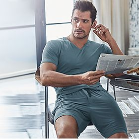 David Gandy wearing green loungewear pyjamas