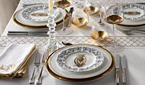 Table set with gold-trimmed plates and glasses