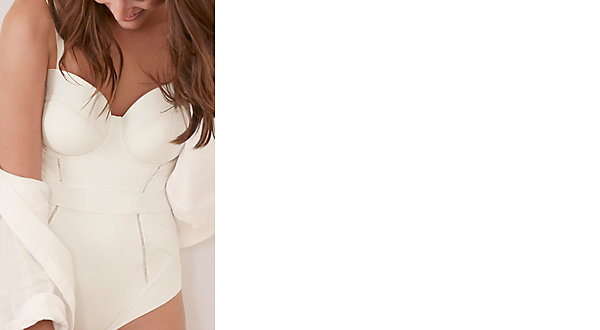 Woman wearing open white shirt and white shaping body