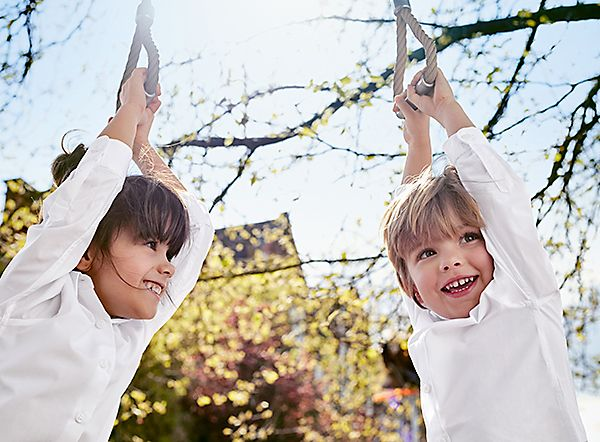 Kids hanging out in white cotton M&S shirts