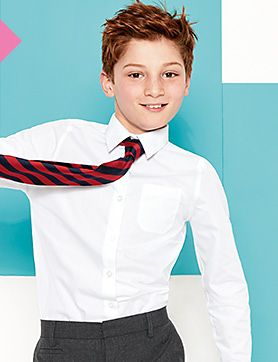 A boy wearing a white shirt and a school tie