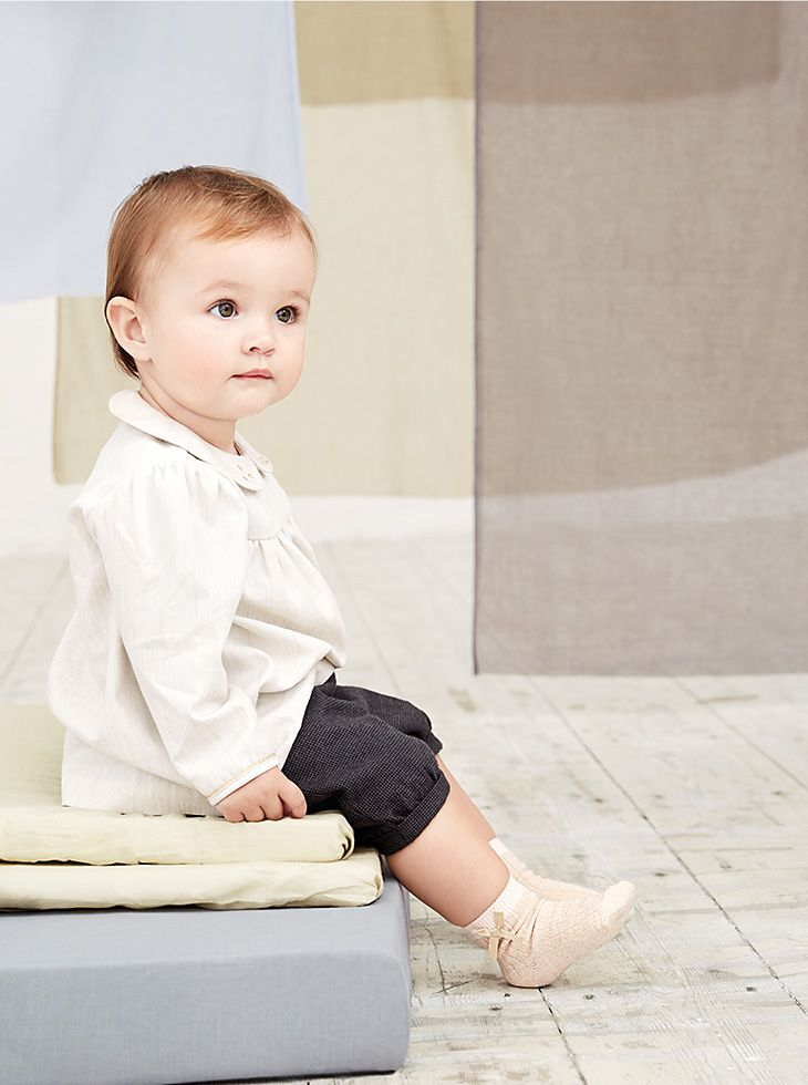 Baby in Marie-Chantal white shirt and trousers
