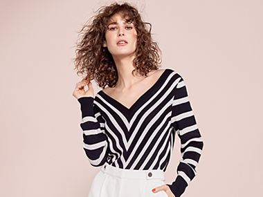 Woman modelling striped top and white trousers