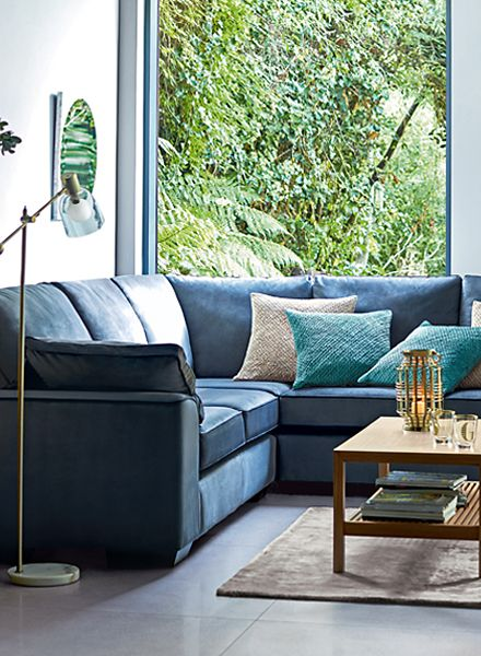 Blue L-shaped sofa in front room