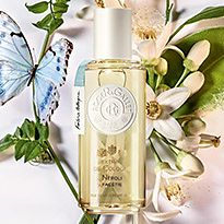 Roger & Gallet fragrance perched next to a butterfly and flowers
