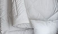Duvets and pillows on a bed