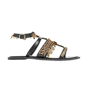 Black and white sandals with charm details
